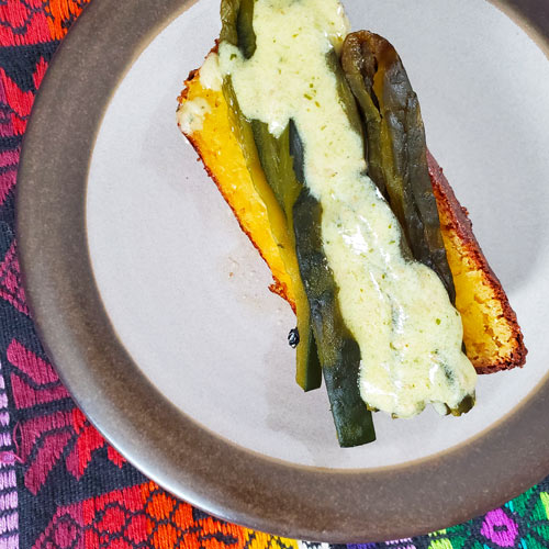 Frida's Corn Pudding with Tomatillo Crema Sauce and Roasted Poblanos from Gallery of Food